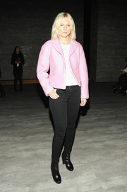 Laura Brown sweetened up her look with a pink cropped jacket during the Zimmermann fashion show.