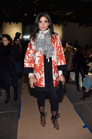 Rachel Roy sealed off her eclectic look with a pair of animal-print ankle-tie heels.
