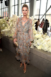 Nicky Hilton coordinated her footwear with a snakeskin clutch by Bottega Veneta.