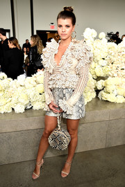 Sofia Richie got frilled up in a cream-colored ruffle blouse by Zimmermann for the brand's Spring 2019 show.