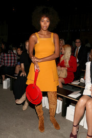 Solange Knowles went for a striking color combo, pairing her orange dress with a red purse.