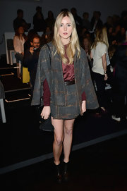 Diana Vickers' tweed mini skirt matched her cape and pulled together her whole look at the Zoe Jordan runway show.