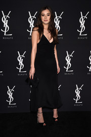 Hailee Steinfeld complemented her dress with black ankle-strap peep-toes by Jimmy Choo.