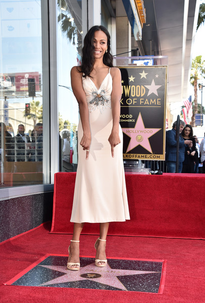 Zoe Saldana looked sweet and sophisticated in a bow-adorned slip dress by Miu Miu during her Walk of Fame Star ceremony.