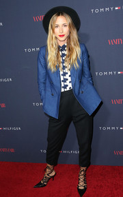 Gillian Zinser went for a masculine-chic vibe in a double-breasted blue blazer layered over a polka-dot button-down during the Zooey Deschanel and Tommy Hilfiger collection debut.