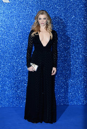 Natalie Dormer accessorized her look with an elegant silver box clutch.