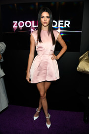 Kendall Jenner paired her cute dress with white ankle-strap pumps by Christian Louboutin.