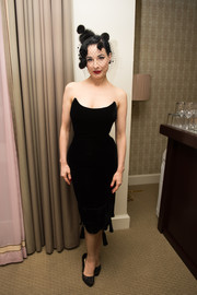 Dita Von Teese flaunted her hourglass figure in a skintight black strapless dress at the Zuhair Murad cocktail party.