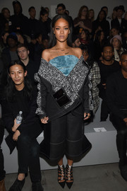 Rihanna amped up the edge factor in a hot-off-the-runway denim jacket by Julia Seemann during the adidas Originals x Kanye West fashion show.