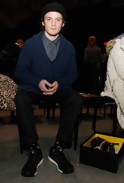 Anton Yelchin stayed cool and casual in a navy blue shawl-collar cardigan while attending an event for Adidas.