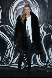 Jessica Hart looked posh in a thick black fur coat during the Alice + Olivia fashion show.