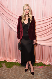 Nicky Hilton Rothschild matched her jacket with a pair of Alice + Olivia velvet pumps.