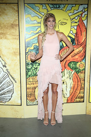 Devon Windsor went ultra girly in a pale-pink halter dress with ruffle detailing and a high-low hem during the Alice + Olivia fashion show.