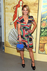 Candace Cameron Bure added an extra pop of color with a blue and gray mixed-material purse.