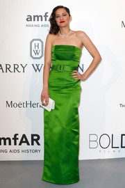 Marion Cotillard exuded timeless glamour in a lime-green strapless dress by Jean Paul Gaultier Couture at the amfAR Cinema Against AIDS Gala.