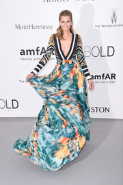 Toni Garrn donned a deep-V Elie Saab gown that oozed plenty of graphic appeal for the amfAR Cinema Against AIDS Gala.