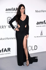 Adriana Lima put plenty of skin on display in a low-cut, high-slit cutout gown by Alexandre Vauthier during the amfAR Cinema Against AIDS Gala.