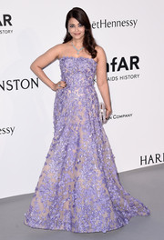 Aishwarya Rai looked downright divine in an appliqued lavender strapless gown by Elie Saab Couture at the amfAR Cinema Against AIDS Gala.
