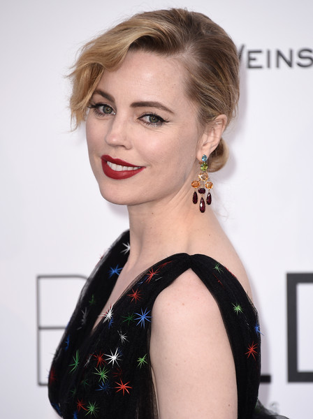 Melissa George styled her hair in an elegant chignon with wavy, side-swept bangs for the amfAR Cinema Against AIDS Gala.