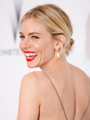 Sienna Miller went for edgy styling with this twisted bun during the amfAR Cinema Against AIDS Gala.