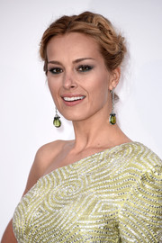 Petra Nemcova sported a twisty ponytail when she attended the amfAR Cinema Against AIDS Gala.