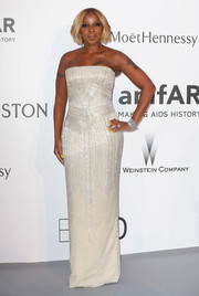 Mary J. Blige slipped into a crystal-adorned white strapless gown by Versace for the amfAR Cinema Against AIDS Gala.