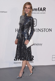 Eva Herzigova dazzled in a fully sequined turtleneck dress by Christian Dior at the amfAR Cinema Against AIDS Gala.