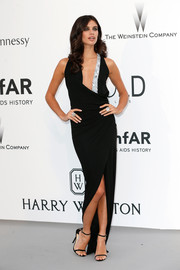 Sara Sampaio oozed sultry elegance at the amfAR Cinema Against AIDS Gala in a black Alexandre Vauthier wrap gown with a beaded neckline.