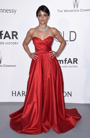 Michelle Rodriguez got majorly dolled up in a floor-sweeping red strapless gown by Romona Keveza for the amfAR Cinema Against AIDS Gala.