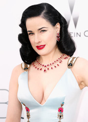 Dita Von Teese attended the amfAR Cinema Against AIDS Gala wearing her signature vintage-style curls.