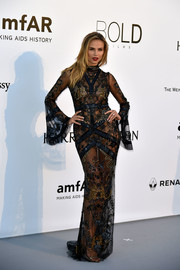 Natasha Poly bared plently of flesh in a sheer, snake-embellished gown by Roberto Cavalli at the amfAR Cinema Against AIDS Gala.