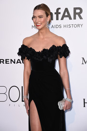 Karlie Kloss amped up the glamour with this gemstone clutch by Judith Leiber paired with an off-the-shoulder gown at the amfAR Cinema Against AIDS Gala.