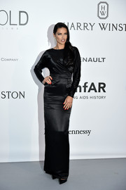 Adriana Lima went for understated elegance in a long-sleeve black satin column dress by Alexander Terekhov at the amfAR Cinema Against AIDS Gala.