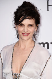Juliette Binoche looked elegant despite the messy updo at the amfAR Cinema Against AIDS Gala.