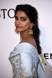 Sonam Kapoor looked romantic with her loose braid at the amfAR Cinema Against AIDS Gala.