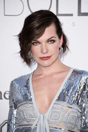 Milla Jovovich sported short, half-pinned waves at the amfAR Cinema Against AIDS Gala.