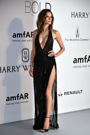 Alessandra Ambrosio's Redemption gown at the amfAR Cinema Against AIDS Gala was all sorts of sexy with its sheer fabric, plunging neckline, and hip-grazing slit!
