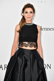Clotilde Courau flashed some skin in a black lace-accented crop-top at the 2017 amfAR Cinema Against AIDS Gala.