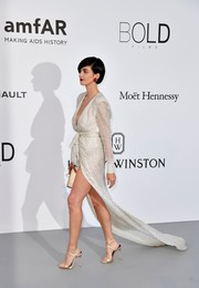 Paz Vega paired her stylish dress with nude satin sandals.