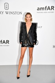 Anja Rubik went for bold glamour in a pointy-shouldered sequin dress by Saint Laurent at the amfAR Gala Cannes 2017.