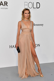 Natasha Poly looked alluring in a high-slit nude empire gown by Dsquared2 at the amfAR Gala Cannes 2017.