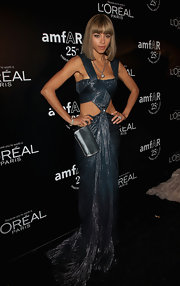 Ana is drop dead gorgeous in a dramatic pleated cutout evening gown at the amfAR Gala.