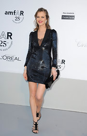 Eva Herzigova complemented her tight sequined dress with a rectangular black satin clutch.