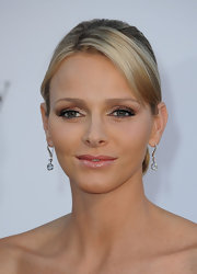 Charlene Wittstock wore an icy white and shimmering metallic copper shadow at the 64th Annual Cannes Film Festival.