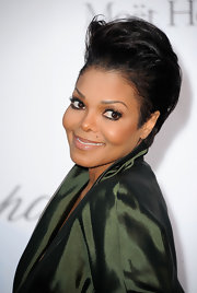 Janet Jackson rocked a cropped straight cut at the amfAR Gala in Cannes. She added height to her locks by teasing the roots.