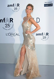Bar Refaeli is always a bombshell. She just throws on a dress and voila—perfection. At amfAR's 25th anniversary Cinema Against AIDS gala, the model strutted her stuff in Roberto Cavalli's ombré beaded and feathered gown. She finished the look with gold slingback sandals and a perfect model pose.
