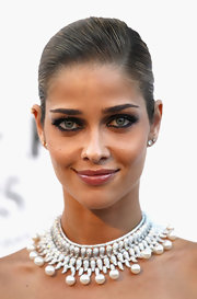 Ana Beatriz Barros opted for a sleek updo when she attended the amfAR Gala.