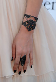 Charlotte accessorized her girly ensemble with an intricate and darkly chic cocktail ring.