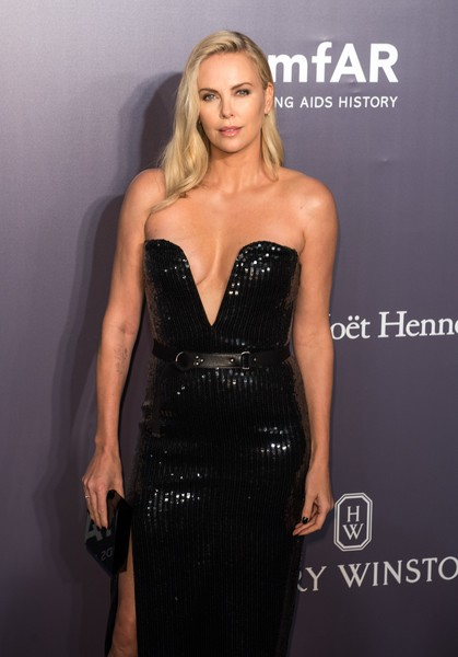 Charlize Theron graced the amfAR Hong Kong Gala sporting a black box clutch and strapless gown combo.