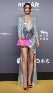 Shanina Shaik showcased her mile-long legs in a silver Galia Lahav Couture sequin dress with a high-low hem at the 2018 amfAR Hong Kong Gala.